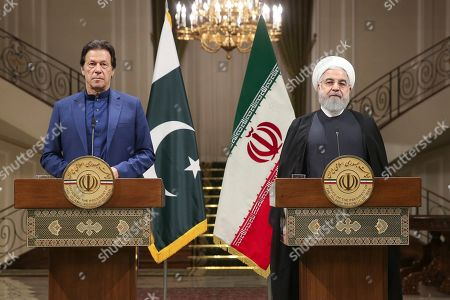 Stock Image of Hassan Rouhani, Imran Khan. In this photo released by the official website of the office of the Iranian Presidency, Iranian President Hassan Rouhani, right, and Pakistani Prime Minister Imran Khan give a joint press conference at the Saadabad Palace, in Tehran, Iran