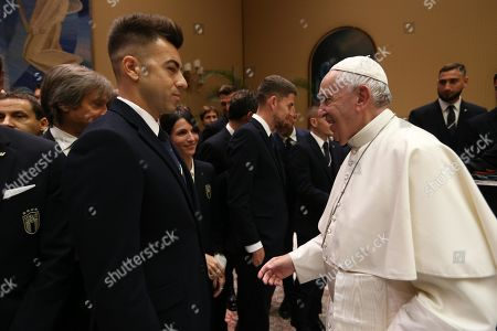 Stock Image of A handout photo made available by Italian Football Federation (FIGC) press office shows Pope Francis (R) meeting Italy soccer team player Stephan El Shaarawy (C) at the Vatican, 13 October 2019.