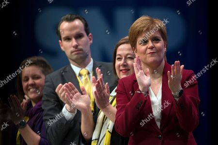 Stock Photo of Kirsty Blackman, Angus MacLeod, National Secretary of the Scottish National Party (SNP), Kirsten Oswald, SNP Business Convener, and Nicola Sturgeon, First Minister of Scotland and Leader of the Scottish National Party (SNP), applaud Ian Blackford, SNP Westminster leader