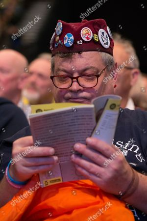 Steve Davies, SNP Delegate reads the conference handbook