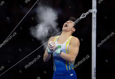 Arthur Mariano of Brazil celebrates during the Horizontal bar men's Apparatus Final at the FIG Artistic Gymnastics World Championships in Stuttgart, Germany, 13 October 2019.