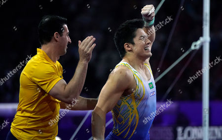Arthur Mariano (R) of Brazil celebrates during the Horizontal Bars men's Final at the FIG Artistic Gymnastics World Championships in Stuttgart, Germany, 13 October 2019.