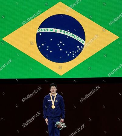 Arthur Mariano of Brazil poses during the Award Ceremony after winning the Horizontal Bars men's Final at the FIG Artistic Gymnastics World Championships in Stuttgart, Germany, 13 October 2019.