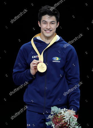 Arthur Mariano of Brazil cheers during the Award Ceremony after winning the Horizontal Bars men's Final at the FIG Artistic Gymnastics World Championships in Stuttgart, Germany, 13 October 2019.