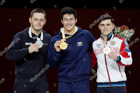First placed Arthur Mariano (C) of Brazil, second placed Tin Srbic of Croatia (L) and third placed Artur Dalaloyan (R) of Russia cheer after the Horizontal Bars men's Final at the FIG Artistic Gymnastics World Championships in Stuttgart, Germany, 13 October 2019.
