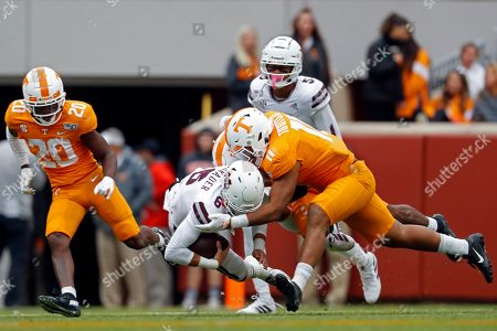 Stock Photo of Mississippi State quarterback Garrett Shrader (6) is tackled by Tennessee defensive back Shawn Shamburger (12) and linebacker Henry To'o To'o (11) in the second half of an NCAA college football game, in Knoxville, Tenn