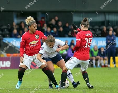 Stock Photo of Kit Graham of Tottenham Hotspur Women sees her route to goal blocked by Lauren James and Jane Ross of Manchester United Women during Tottenham Hotspur Women vs Manchester United Women, Barclays FA Women's Super League Football at the Hive Stadium on 13th October 2019