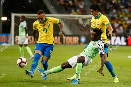 Stock Picture of Everton of Brazil (L) and William Troost-Ekong of Nigeria (C) in action during an international friendly match between Brazil and Nigeria at the National Stadium in Singapore, 13 October 2019.