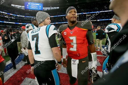 Carolina Panthers quarterback Kyle Allen (7) and Tampa Bay Buccaneers quarterback Jameis Winston (3) meet at midfield after playing in an NFL football game, at Tottenham Hotspur Stadium in London