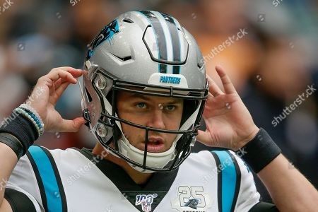 Carolina Panthers quarterback Kyle Allen (7) warms up before an NFL football game against the Tampa Bay Buccaneers, at Tottenham Hotspur Stadium in London