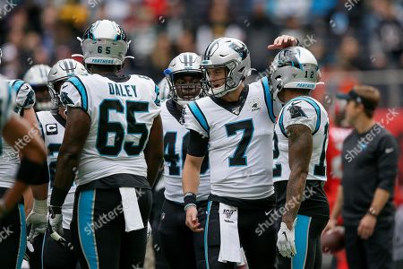 Carolina Panthers quarterback Kyle Allen (7) huddles with teammates before an NFL football game against the Tampa Bay Buccaneers, at Tottenham Hotspur Stadium in London