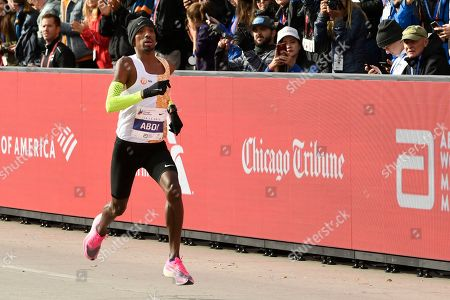 Bashir Abdi of Belgium, finishes fifth during the Chicago Marathon, in Chicago