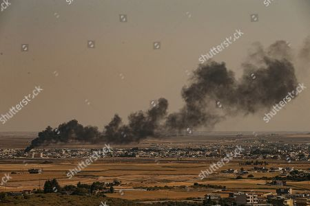 From the Turkish side of the border between Turkey and Syria, in Ceylanpinar, Sanliurfa province, southeastern Turkey, smoke billows from fires on targets in Ras al-Ayn, Syria, caused by bombardment by Turkish forces, . Turkey's President Recep Tayyip Erdogan has rejected offers for mediation with Syrian Kurdish fighters as the Turkish military continues its offensive against them in northern Syria