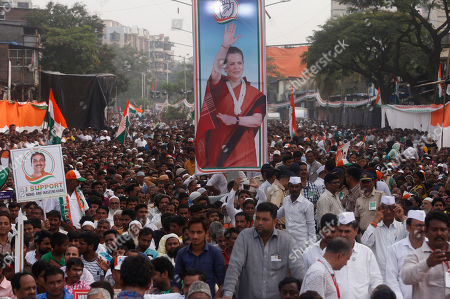 Supporters of India's Congress party participates in an election campaign ahead of Maharashtra state elections in Mumbai, India, Sunday, Oct, 13, 2019. The polling is scheduled to be held on October 21. A photograph of party president Sonia Gandhi is in center