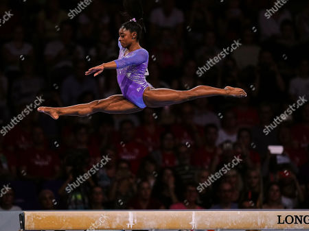 Simone Biles of United States of America competing in balance beam for women during the 49th FIG Artistic Gymnastics World Championships at the Hanns Martin Schleyer Halle in Stuttgart, Germany