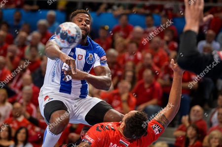 Rogerio Moraes Ferreira (R) of Telekom Veszprem in action against Victor Manuel Iturriza Alvarez of FC Porto Sofarma during the men's handball EHF Champions League match Telekom Veszprem vs. FC Porto Sofarma in Veszprem, Hungary, 13 October 2019.