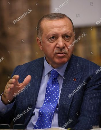 Turkey's President Recep Tayyip Erdogan speaks to Turkish journalists, in Istanbul, . Erdogan has rejected offers for mediation with Syrian Kurdish fighters as the Turkish military continues its offensive against them in northern Syria
