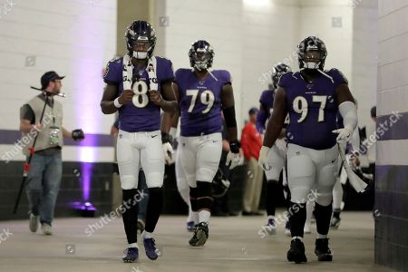 Baltimore Ravens quarterback Lamar Jackson (8), offensive tackle Ronnie Stanley (79) and defensive tackle Michael Pierce (97) walk toward the field prior to an NFL football game against the Cincinnati Bengals, in Baltimore