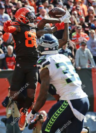Cleveland Browns wide receiver Jarvis Landry (80) can't make the catch during the first half of an NFL football game against the Seattle Seahawks, in Cleveland