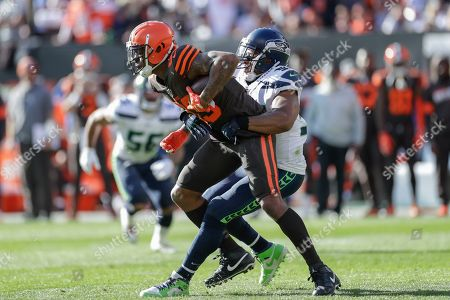 Cleveland Browns Ricky Seals-Jones (83) is tackled by Seattle Seahawks middle linebacker Bobby Wagner (54) after a pass reception during the second half of an NFL football game, in Cleveland