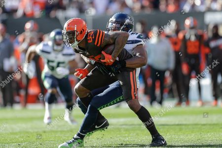 Stock Picture of Cleveland Browns Ricky Seals-Jones (83) is tackled by Seattle Seahawks middle linebacker Bobby Wagner (54) after a pass reception during the second half of an NFL football game, in Cleveland
