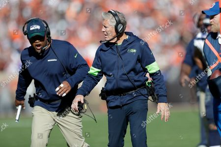 Seattle Seahawks head coach Pete Carroll and defensive coordinator Ken Norton watch during the second half of an NFL football game against the Cleveland Browns, in Cleveland
