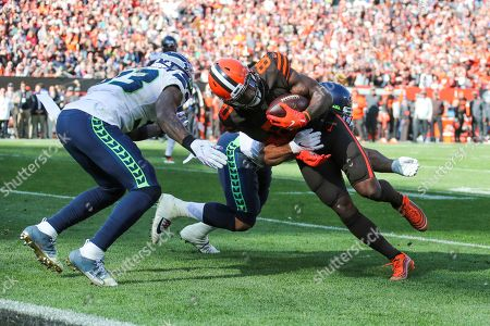 Cleveland Browns wide receiver Jarvis Landry (80) is plays against Seattle Seahawks linebacker Mychal Kendricks (56) and Tedric Thompson (33) during the second half of an NFL football game, in Cleveland