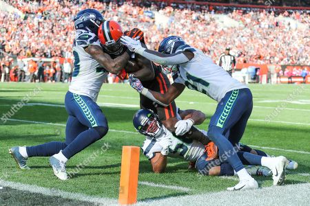 Cleveland Browns wide receiver Jarvis Landry (80) is plays against Seattle Seahawks linebacker Mychal Kendricks (56), Tedric Thompson (33) and Tre Flowers (21) during the second half of an NFL football game, in Cleveland