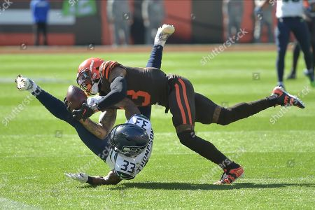 Cleveland Browns wide receiver Odell Beckham Jr. (13) makes a catch against Seattle Seahawks free safety Tedric Thompson (33) during an NFL football game, in Cleveland. The Seahawks won 32-28