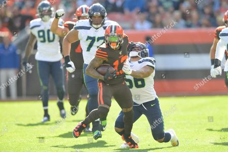 Cleveland Browns wide receiver Odell Beckham Jr. (13) runs with the ball against Seattle Seahawks linebacker Mychal Kendricks (56) during an NFL football game, in Cleveland. The Seahawks won 32-28