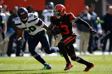 Cleveland Browns wide receiver Odell Beckham (13) runs the ball after a catch against the Seattle Seahawks during an NFL football game, in Cleveland