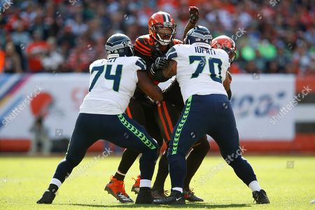 George Fant, Mike Iupati, Myles Garrett. Seattle Seahawks offensive tackle George Fant (74) and offensive guard Mike Iupati (70) block Cleveland Browns defensive end Myles Garrett (95) during an NFL football game, in Cleveland