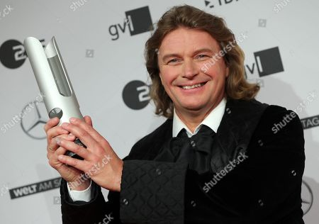 German operatic tenor Klaus Florian Vogt poses with his award during the 'Opus Klassik' award ceremony at the Konzerthaus music hall in Berlin, Germany, 13 October 2019. The Opus Klassik is a German classical music prize, presented in 24 categories.