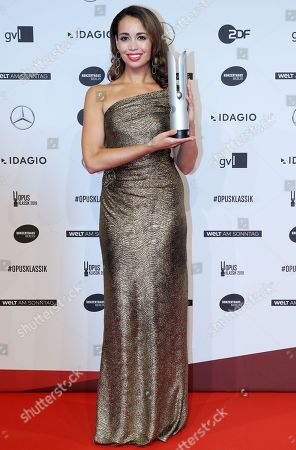 US soprano Nadine Sierra poses with her award for Best Young Singer during the 'Opus Klassik' award ceremony at the Konzerthaus music hall in Berlin, Germany, 13 October 2019. The Opus Klassik is a German classical music prize, presented in 24 categories