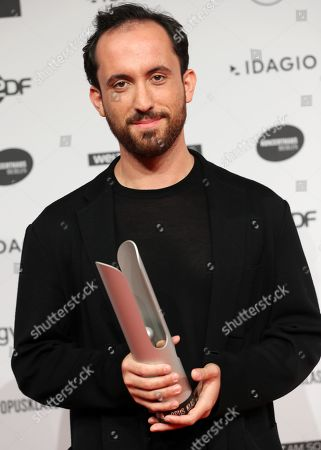 Russian-German pianist Igor Levit poses with his award for Best Instrumentalist during the 'Opus Klassik' award ceremony at the Konzerthaus music hall in Berlin, Germany, 13 October 2019. The Opus Klassik is a German classical music prize, presented in 24 categories