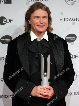 Stock Image of German operatic tenor Klaus Florian Vogt poses with his award during the 'Opus Klassik' award ceremony at the Konzerthaus music hall in Berlin, Germany, 13 October 2019. The Opus Klassik is a German classical music prize, presented in 24 categories.