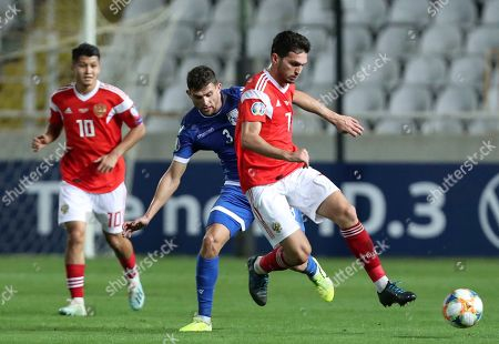 Russia's Magomed Ozdoev, right, duels for the ball with Cyprus' Nicholas Ioannou during the Euro 2020 group I qualifying soccer match between Cyprus and Russia at Georges St-Pierre stadium in Nicosia, Cyprus