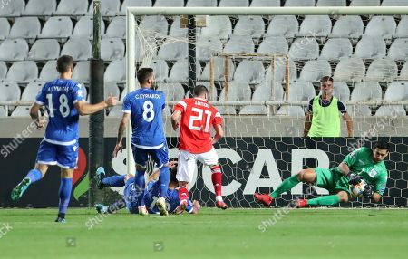 Cyprus' goalkeeper Kostas Panayi, right, makes a save in front of Russia's Aleksei Ionov, second right, during the Euro 2020 group I qualifying soccer match between Cyprus and Russia at Georges St-Pierre stadium in Nicosia, Cyprus