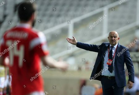 Russia's coach Stanislav Cherchesov, right, gives instructions to Russia's Georgi Dzhikiya during the Euro 2020 group I qualifying soccer match between Cyprus and Russia at Georges St-Pierre stadium in Nicosia, Cyprus