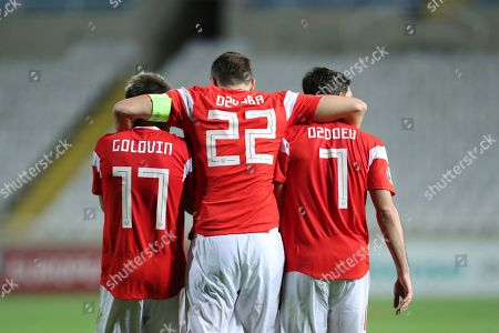 Russia's Artem Dzyuba, center, celebrates with Pavel Mogilevets, left, and Magomed Ozdoev after scoring his side's third goal during the Euro 2020 group I qualifying soccer match between Cyprus and Russia at Georges St-Pierre stadium in Nicosia, Cyprus