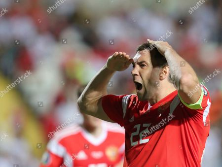 Russia's Artem Dzyuba celebrates after scoring his side's third goal during the Euro 2020 group I qualifying soccer match between Cyprus and Russia at Georges St-Pierre stadium in Nicosia, Cyprus