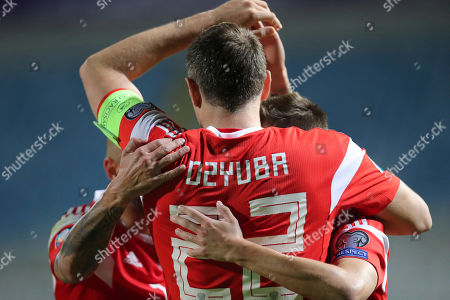 Russia's Artem Dzyuba, front, celebrates with teammates after scoring his side's third goal during the Euro 2020 group I qualifying soccer match between Cyprus and Russia at Georges St-Pierre stadium in Nicosia, Cyprus