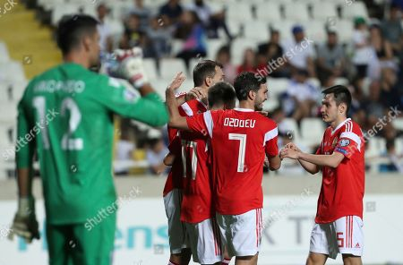 Russia's Aleksandr Golovin celebrates with teammates after scoring his side's fourth goal during the Euro 2020 group I qualifying soccer match between Cyprus and Russia at Georges St-Pierre stadium in Nicosia, Cyprus
