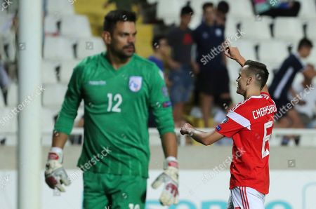 Russia's Denis Cheryshev, right, celebrates after scoring his side's fifth goal during the Euro 2020 group I qualifying soccer match between Cyprus and Russia at Georges St-Pierre stadium in Nicosia, Cyprus