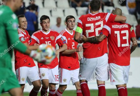 Russia's Denis Cheryshev, second left, celebrates with teammates after scoring his side's fifth goal during the Euro 2020 group I qualifying soccer match between Cyprus and Russia at Georges St-Pierre stadium in Nicosia, Cyprus