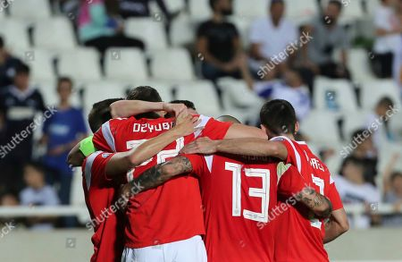 Russia's Denis Cheryshev celebrates with teammates after scoring his side's fifth goal during the Euro 2020 group I qualifying soccer match between Cyprus and Russia at Georges St-Pierre stadium in Nicosia, Cyprus