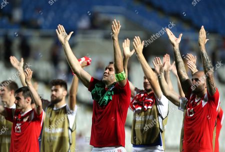 Stock Photo of Russia's Artem Dzyuba, center, celebrates with teammates at the end of the Euro 2020 group I qualifying soccer match between Cyprus and Russia at Georges St-Pierre stadium in Nicosia, Cyprus