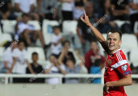 Russia's Denis Cheryshev celebrates after scoring his side's fifth goal during the Euro 2020 group I qualifying soccer match between Cyprus and Russia at Georges St-Pierre stadium in Nicosia, Cyprus