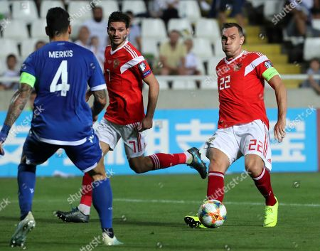 Russia's Artem Dzyuba, right, kicks the ball during the Euro 2020 group I qualifying soccer match between Cyprus and Russia at Georges St-Pierre stadium in Nicosia, Cyprus