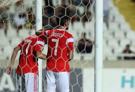 Russia's Aleksandr Golovin, left, celebrates with Russia's Magomed Ozdoev after scoring his side's fourth goal during the Euro 2020 group I qualifying soccer match between Cyprus and Russia at Georges St-Pierre stadium in Nicosia, Cyprus